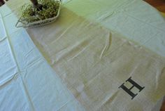 drop cloth tablecloth with burlap runner - top with wildflowers