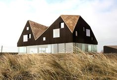 The Dune House by Jarmund/Vigsnæs Architects is a unusual beach home in Suffolk one can rent. It has four double bedrooms and one single, all with bathrooms
