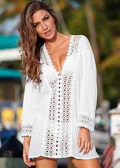 Pack and go! Crinkle rayon is perfect for your next getaway. Venus open crochet trimmed tunic.