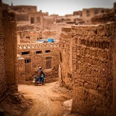A local rides through the dirt alleys of Turpan's picturesque Tuyoq Village. This is what Kashgar's Old City used to look like more than a decade ago. During the summer months the locals sleep on the roofs of these mud-brick homes set at the foot of the Flaming Mountains. Meandering through these alleys like I did last week is one of my favorite things to do in Turpan.