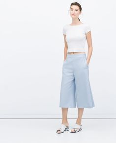 Image 1 of LOOSE FIT TROUSERS WITH PLEATS from Zara