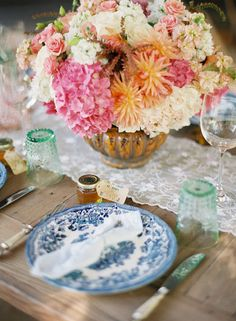 Charming homestyle wedding tablesettings with antique blue china, lace runner and green depression glass tumblers {Kelly Oshiro, Tricia Fountaine Flowers, Photo: Caroline Tran, Style Me Pretty}