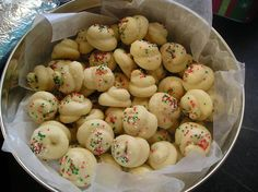 Italian knot cookies. 4 eggs, 1c sugar, 1/2c butter, 2tsp vanilla, 3 1/2c flour, 4tsp baking powder. Sift dry ingredients, and cream the butter with sugar. Beat in the eggs, add vanilla, and dry ingredients. Tie into a knot, or twist into shape. Bake 375 for 10 minutes. Icing- 2 c confectioners sugar, 2 tsp vanilla, 6 tsp water. Dip cookies into icing and sprinkle. You can substitute the vanilla for anise.