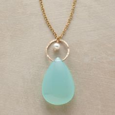 Peruvian chalcedony drops straight from the heavens, suspended beneath a moony cultured pearl and its golden halo
