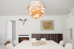 Fireplace & The PH Artichoke Pendant designed by Poul Henningsen (Louis Poulsen). Photography by Tim Van De Velde