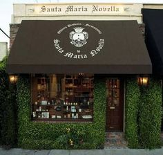 Santa Maria Novella, Luxurious Italian Beauty And Healthcare Brand Available In LA Cafe Restaurant, Restaurant Design, Cafe Design, Store Design, Santa Maria Novella, Small Cafe, Cafe Shop, Lovely Shop, Shop Fronts