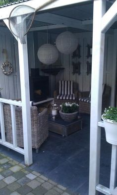 Idea for screened in porch, cozy!