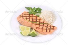 Grilled salmon filler with risotto. ...  Risotto, baked, basil, citrus, closeup, cooked, cut, fillet, fish, food, fresh, fried, gourmet, grilled, healthy, isolated, lime, natural, orange, piece, plate, product, raw, red, rice, round, salmon, sea, slice, slices, squama, steak, white