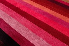 Color Spectrum are woven bands of silk in our classic vegetable dyes. This carpet is a true representation of what Joseph Carini Carpets can offer in color customization, and more! This design is handwoven with high grade silk and woven with all natural vegetable dyes.  Shown in 9' x 12'  MATERIALS: 100% silk