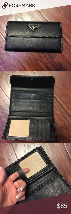 Authentic Prada Wallet Damage shown. No plastic in ID window which is easily repairable. Other than that, perfect condition. Offers welcome! 💼🕶🥂Will be leather conditioned before shipped. Prada Bags Wallets