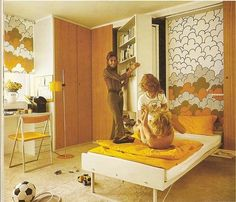 1970s bedroom design.with German modular cupboards.  Look how thin that mattress is!