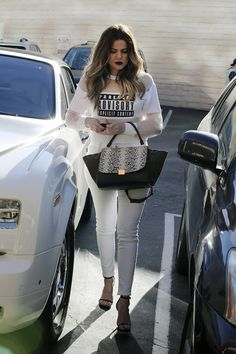 Monochrome Moto: Khloe Kardashian wearing J BRAND's Nicola in Blanc while getting her nails done in Encino.