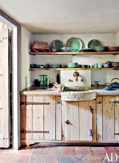 Rustic Kitchen by Axel Vervoordt and Alessio Lipari Architects and Serena Mignatti Architect in Rome, Italy