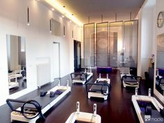Pilates Studio Nice dark wood floors against stark white walls.