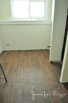 A sneak peek and our downstairs wood-look ceramic tile from Home depot and the transom window insert.