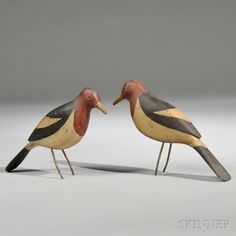 Pair of Carved and Painted Red-headed Woodpecker Figures, American, early 20th century, with painted eyes, boldly painted coloring, and wire legs, lg. 10, 9 in.