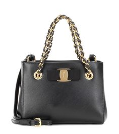 Salvatore Ferragamo - Melike Small leather tote bag - We like Salvatre Ferragamo's Melike tote bag, and we have a sneaky suspicion you'll like it too. Crafted in Italy from textured leather, this compact shopper-style comes with the brand's signature grosgrain bow and a glamorous, jewellery-inspired chain strap. Tote the cute design from shopping spree to lunch dates. seen @ www.mytheresa.com