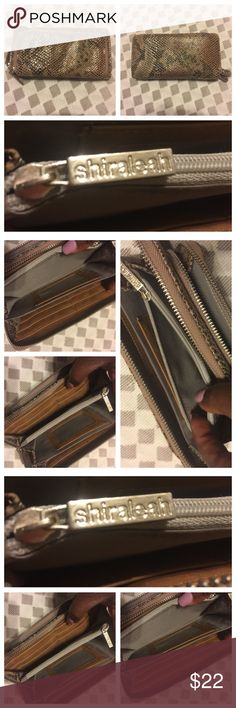 *** Shiraleah*** Snake-Skin Wallet/Purse. *** Shiraleah*** Snake-Skin Wallet/Purse. Double overall zipper closure . One inner zipper compartment, over 12 credit card slots. See photos attached for measurements. Preowned BUT rearly used so inside is in mint condition. No hold, no modeling, and No Trades. Shiraleah Bags Wallets