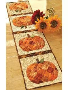 Gorgeous table runner - need to buy sum orange fabric so I can try to make those pumpkins