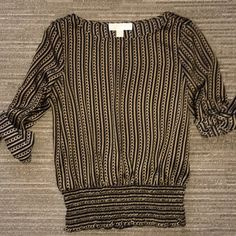 HPMichael Kors blouse EUC. Gold and navy blouse. Gold hardware on sleeves. 100% polyester. Michael Kors Tops Blouses