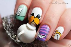Alice in Wonderland nails Im not a fan of the middle finger, but I really like the cheshire cat one. Get Nails, Love Nails, How To Do Nails, Pretty Nails, Hair And Nails, Nail Art Disney, Alice In Wonderland Nails, Crazy Nails, Funky Nails