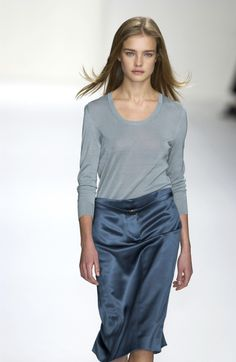 loose straight skirt , deep scoop plain hair