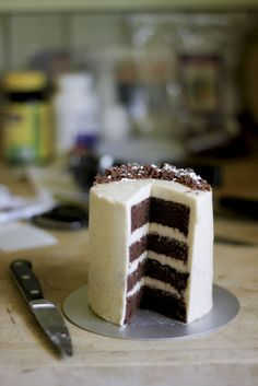 choc. cake with vanilla bean buttercream. also a link at the bottom to how to frost a cake! helpful!