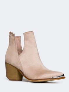 - These classic booties will never go out of style. - Vegan suede ankle boots have a metal tipped toe with a wooden, block heel and side cutouts that make it easy to pull on. - Non-skid sole and cushi