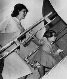 Jacqueline Kennedy, Caroline Kennedy, boarding the Kennedys' private plane for an Easter vacation in Palm Beach, Florida. March 27, 1961