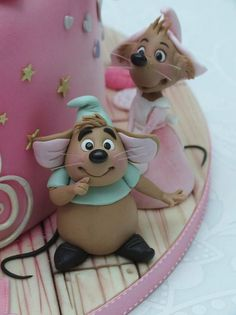 This Terrific Pink Cinderella Cake features Cinderella's pink dress and her blue pumpkin carriage. This Disney cake was made by Emma Jayne Cake Design located in the United Kingdom. I love this scene in Disney's Cinderella where the birds and mice are helping Cinderella make her dress for the ball....