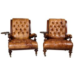 A Rare Pair of 19th C Low Library Armchairs with Wine tables. explore items from 1,700  global dealers at 1stdibs.com