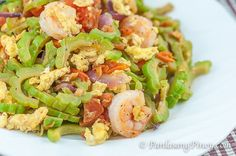 Ginisang Ampalaya with Shrimp (or sautéed bitter gourd) is a simple yet nutritious dish that you can prepare for lunch. This recipe involves bitter gourd (also called bitter melon), which is a type of vegetable that is known to have a lot of nutritional value. Entree Recipes, Seafood Recipes, Asian Recipes, New Recipes, Cooking Recipes, Healthy Recipes, Ethnic Recipes, Asian Foods, Delicious Recipes