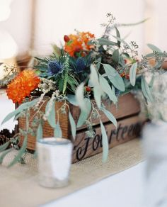 Wedding centerpieces wooden box: I would change the flowers and cram a ton of white roses instead