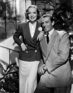 Marlene Dietrich and Gary Cooper. Nice to see a smile on lovely Marlene.