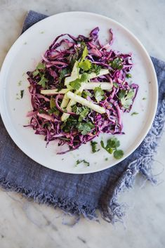 This slaw is magic. Red cabbage, tart granny smith apples, the slight heat of a jalapeño, and the bright flavors of mint and cilantro...it simply cannot be beat.