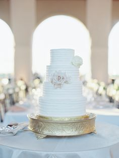 Gorgeous all-white cake: http://www.stylemepretty.com/missouri-weddings/st-louis/2015/08/26/classic-forest-park-wedding-at-the-historic-worlds-fair-pavilion/ | Photography: Clary Photo - http://claryphoto.com/