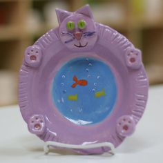 Clay Kitty plate...love the fish bowl belly