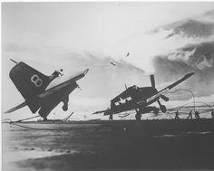 Grumman F6F Hellcat fighter breaks after a crash landing on light carrier USS Princeton, date unknown.
