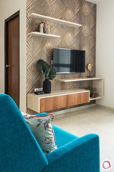 This compact home at Lodha Amara Thane has functional and custom interiors on a budget. Let us tour this home to explore its design story Tv Unit Interior Design, Tv Unit Furniture Design, Bedroom Furniture Design, Lcd Unit Design, Small Room Furniture, Lcd Wall Design, Small Space Interior Design, Tv Furniture, Interior Modern