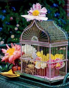 A vintage birdcage makes a novel centerpiece when filled with flowers.