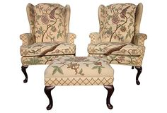 Clyde Pearson pair of wingback armchairs and a matching ottoman.  Fine hand-embroidered crewelwork textile.  Curated by Fragments Identity