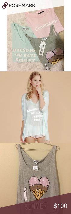 """🌸Wildfox Pastel Spring Tee Bundle🌸 Perfect for pastel lovers out there, this Wildfox bundle celebrates champagne, ice cream and dessert in 3 total pieces. Relaxed fit for a M-L. Please note the size and conditions:  1) Minty """"Around Here We Have Dessert"""" 🍰 Sunday Morning V-Neck: Medium. Oversized fit. Only worn a few times.  2) Baby pink """"Champagne!"""" 🥂 T-Shirt: Large. Doesn't fit as big as the minty tee. Relaxed fit. Worn once!  3) Grey """"I Heart Summer"""" Tank 🍦: Medium. Brand New With…"""