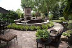 Unilock Outdoor Living Patio with a Brussels Block Fireplace paver