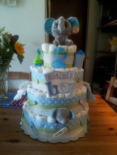 4-layer Elephant baby Boy Diaper Cake Theme Color: gray, baby blue, light green / sage green with baby essentials Https://www.facebook.com/vivboutique