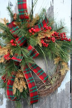 Christmas Wreath, Pine, Red Berries, Gold Pine, Plaid Ribbon. $90,00, via Etsy.