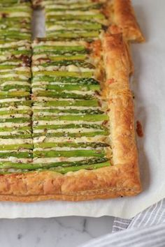 Gorgeous and impressive, this Asparagus Gruyere Tart makes for a delicious appetizer or main dish. It's also super EASY to make! You've got to try this! #brunch #tart #savory