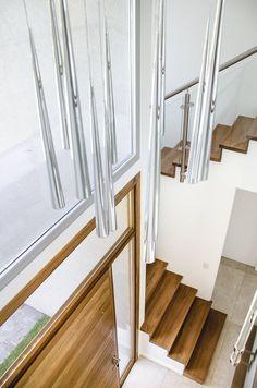hall: Pasillos, vestíbulos y escaleras de estilo translation missing: ar.style.pasillos-vestíbulos-y-escaleras.moderno por Parrado Arquitectura