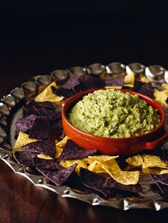 Although I have called this incredible dip roquamole, I think it may be better made with a less illustrious bleu. St Agur out of a wedge-shaped packet is the blue cheese I keep in the fridge so that I am ever-ready to make this. You don't need to serve subfusc blue corn tortilla chips with this; you don't have to serve any kind of tortilla chip with this: though both do add to the luscious eat-me quality. But I'm also very keen on a huge platter of dippable bits: radishes, carrot...