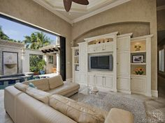 Family Room - built in entertainment center - open to the lanai.  Olde Naples, FL