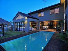 Swimming pool landscape with timber deck